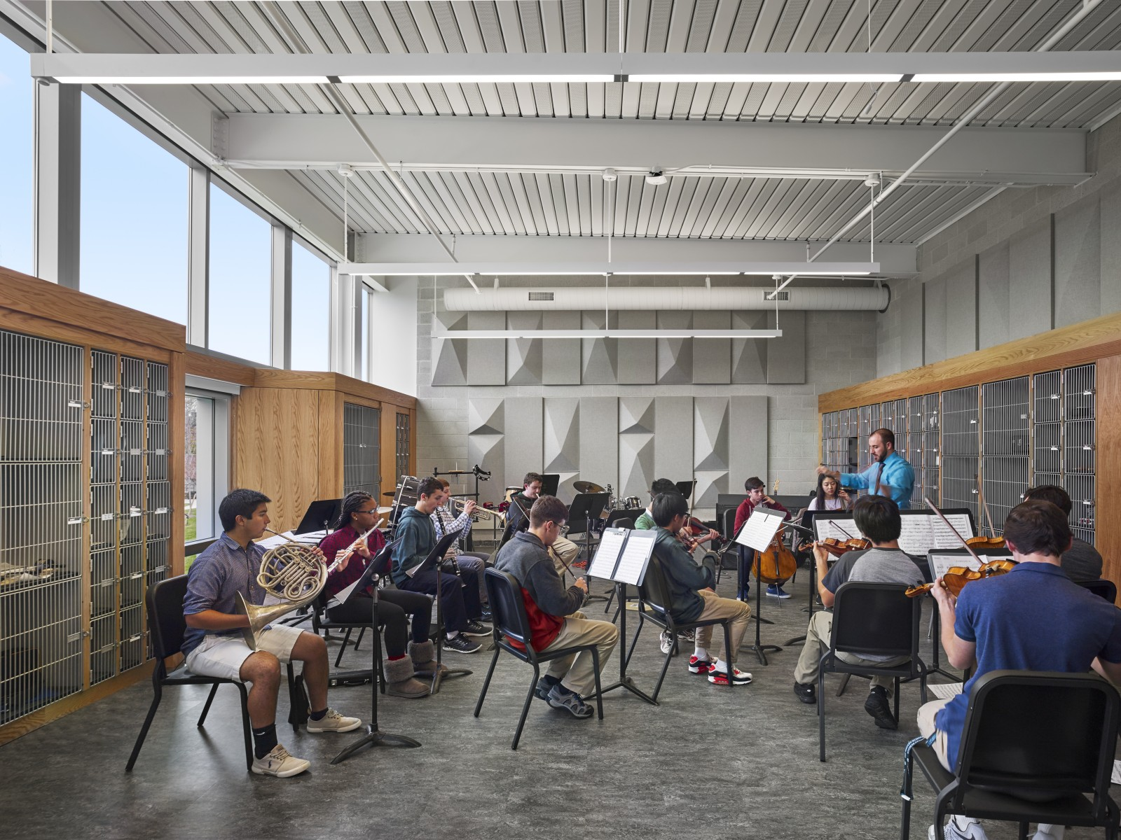 Students playing instruments in new Ensemble Room in newly constructed Shipley Commons