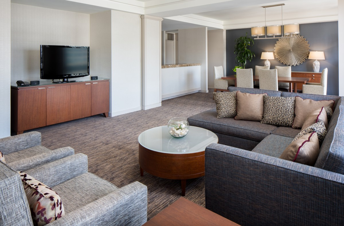 Westin Cincinnati Renovated modern suite featuring flat screen tv and sleek couches