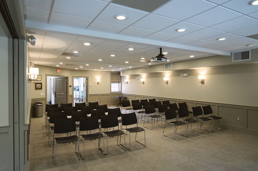 Office fit-out convertible meeting space with projector for speakers