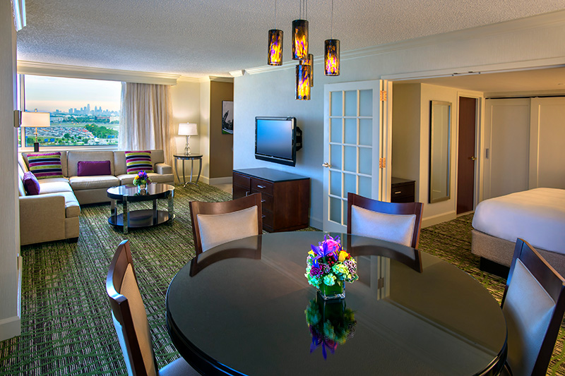 renovated suite showing the dining and living area flatscreen tv and modern decor