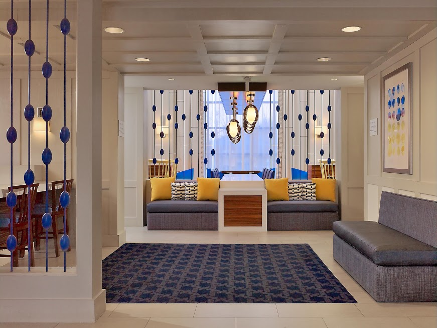 interior lounge area of renovated hotel lobby