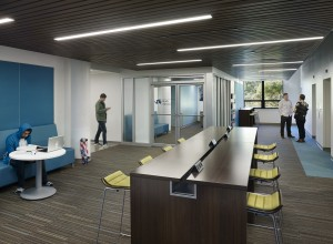 Common area at newly renovated entrepreneurial center-PPPSRB, featuring work stations at shared table