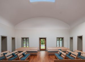 Interior of Quaker Meetinghouse space features a Skyspace, an open air, retractable section of the roof with ancillary lighting created by international artist James Turrell